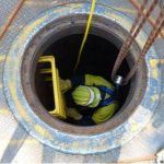 confined space entry worker on ladder cables