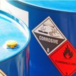 Corrosive and flammable liquids in blue metal barrels