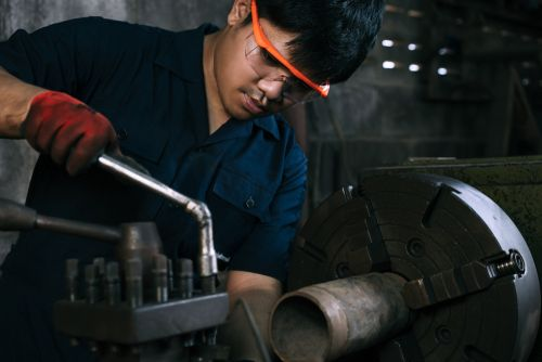 man working with machine tools