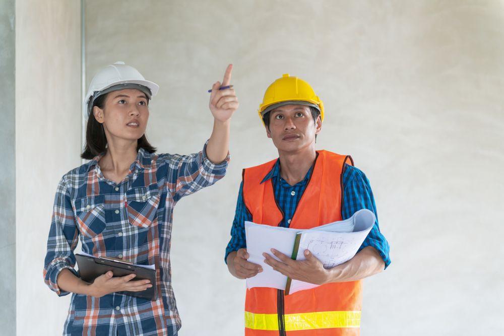 team goes over safety inspection together for worksite safety audit