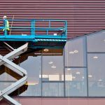Men work at heights on scissor lift safely