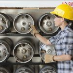 Woman properly storing construction propane in ontario workplace