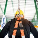 worker attached to fall arrest system for working at heights