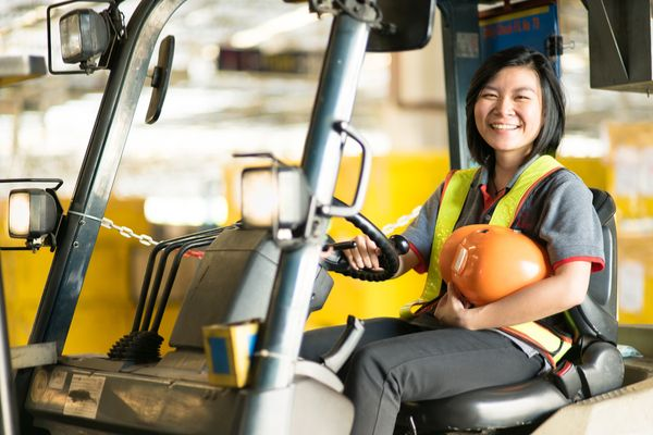 Woman smiling while attending forklift safety training
