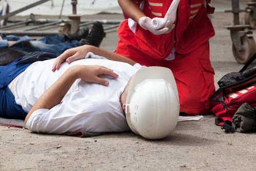 first aid being administered to injured worker