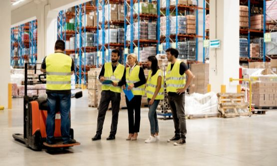 workers in yellow vests in warehouse
