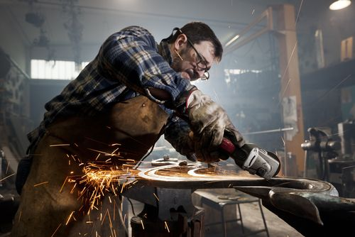 small business welding with safety glasses