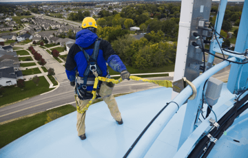 man working safely up high