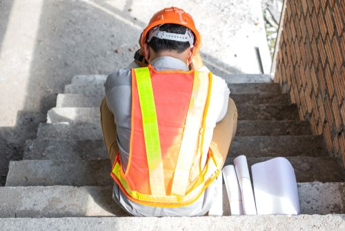 construction worker feels stress at workplace