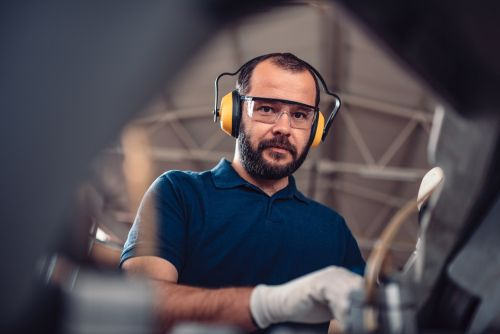 man using headphones at the workplace