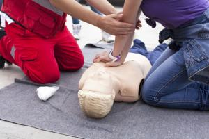 CPR being taught in first aid training session
