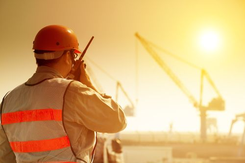 supervisor communicates with staff on hot sunny day at construction site