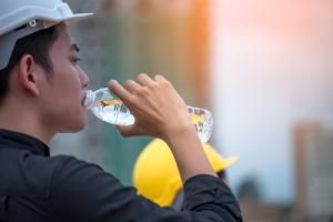 worker drinks water stays hydrated at job site