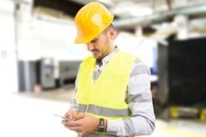 distracted factory worker on phone unsafe