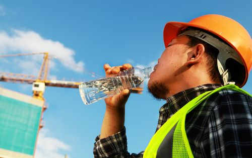 Working Outdoors Safely with Summer Storms & Heat in Mind