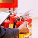employee checking fire extinguishers
