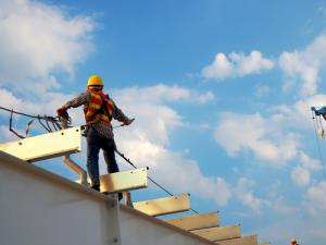 man working at heights on roof