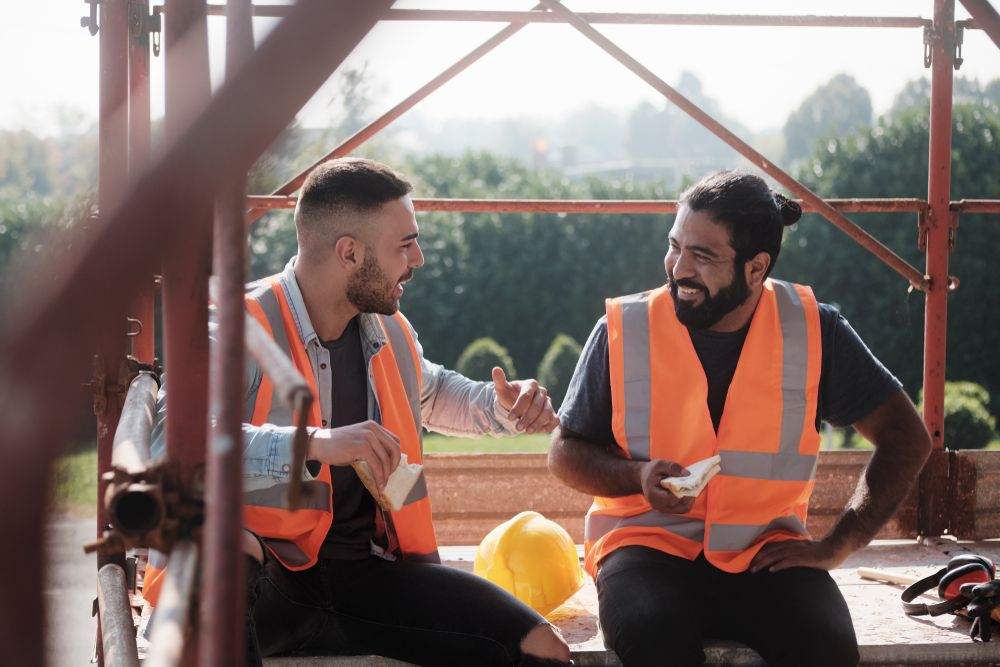 construction workers laughing at work