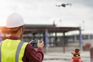 engineer uses drone at construction site