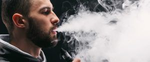 young man vaping