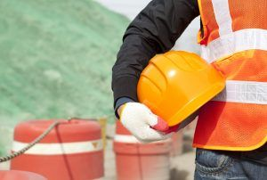 worker with vest and hard hat