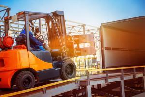 forklift loading onto truck