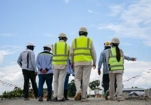 management and site workers assess safety risks