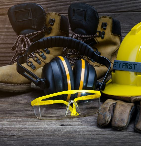 Safety boots, hearing protection, goggles, gloves, and a safety helmet