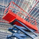 scissor lift operating near top of building