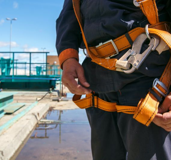 A construction worker wearing a safety harness