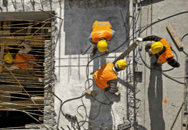 construction workers in safety vests and hard hats