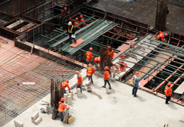 construction workers on a high rise building under construction