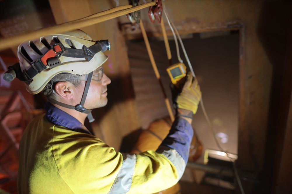 worker with protective equipment in confined space