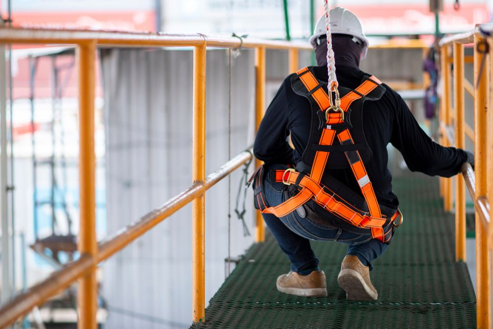 workers in safety gear performing due diligence