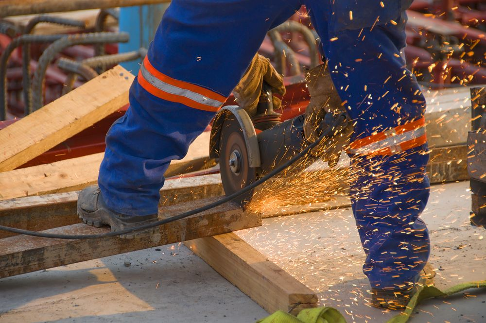 worker operates saw in workplace