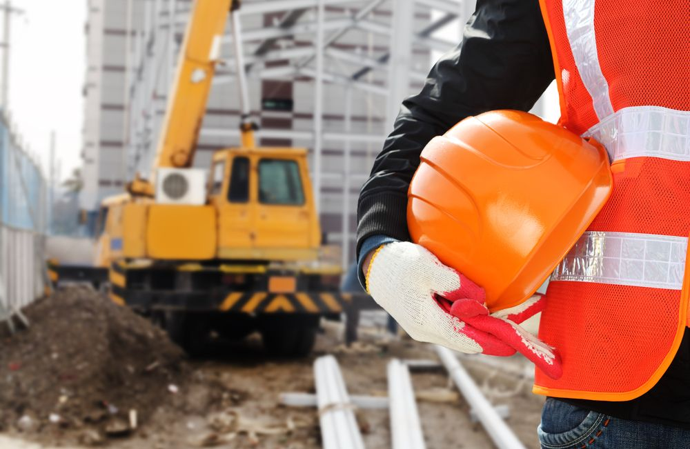 worker with helmet at work site