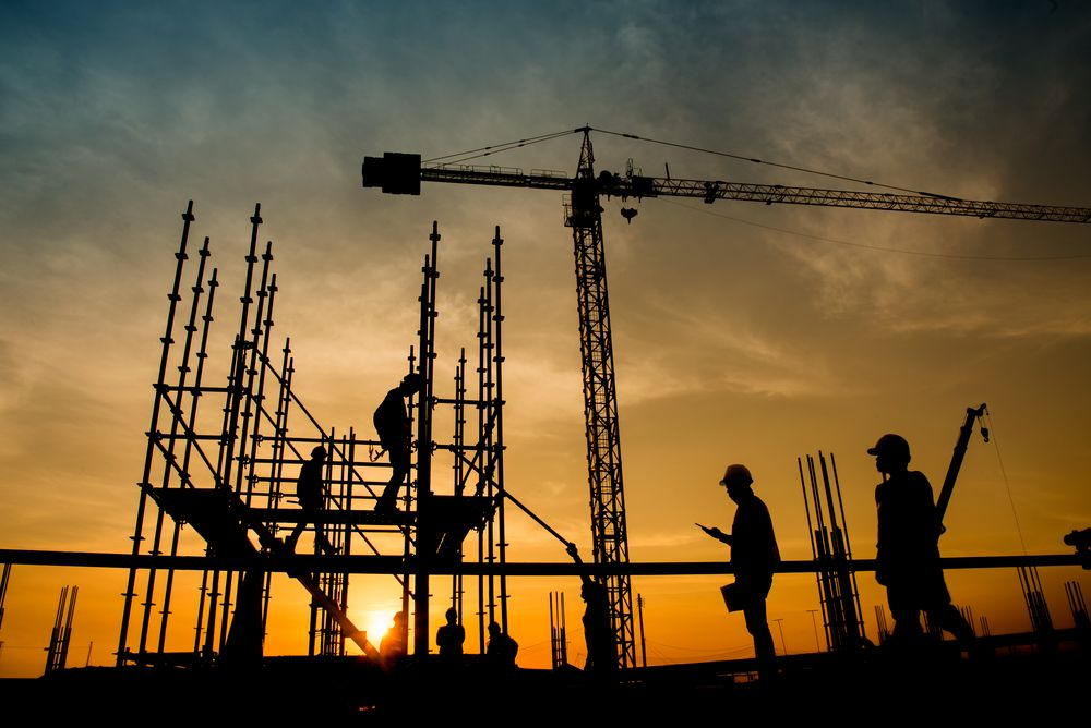 workers at construction site at sunrise