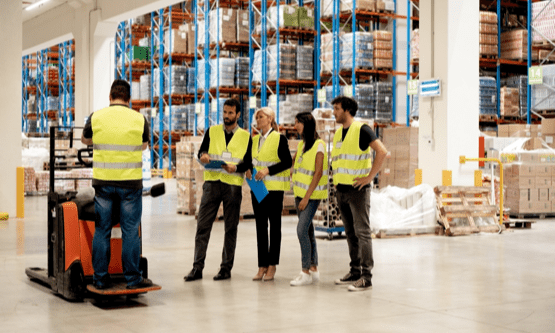 Warehouse workers participate in forklift training