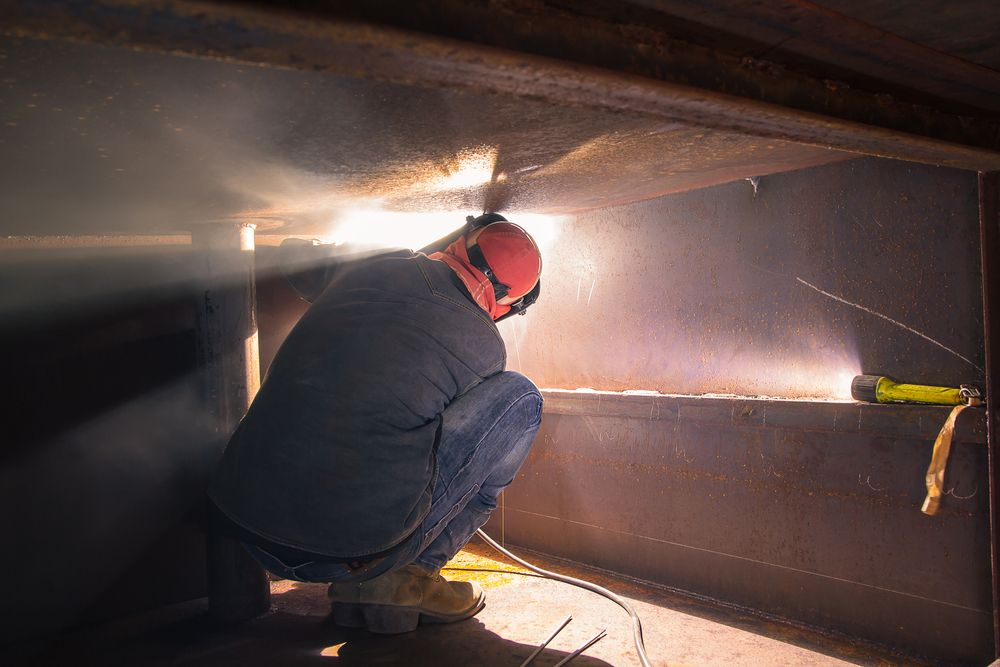 worker trained in confined space entry