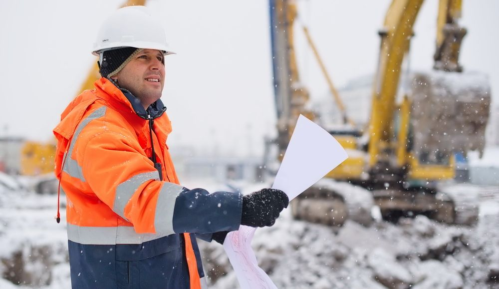 workers at construction site in winter