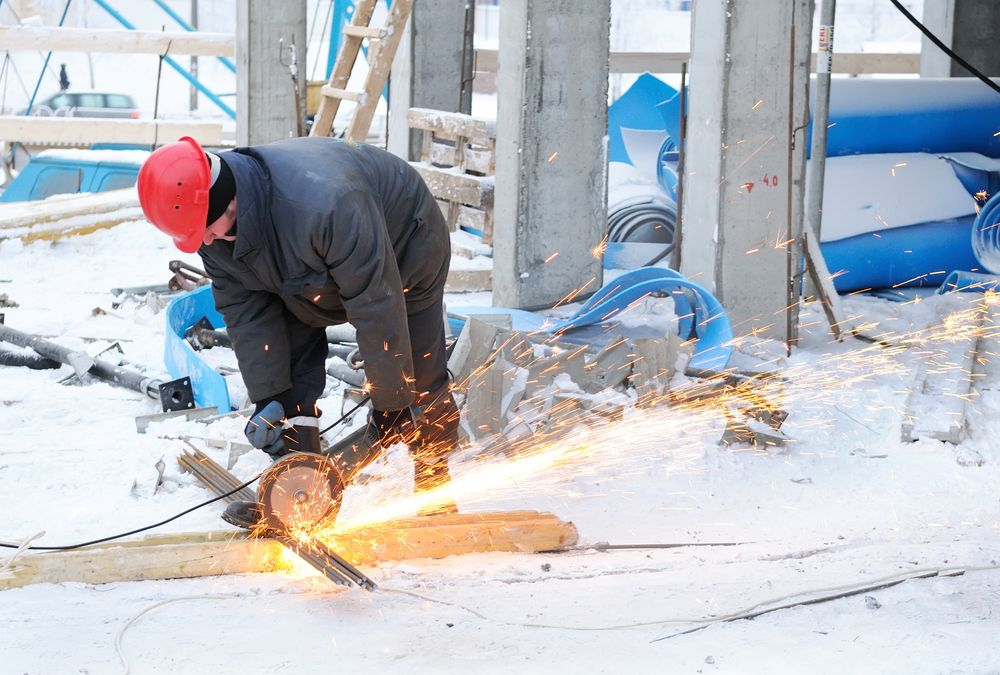worker operating equipment in winter