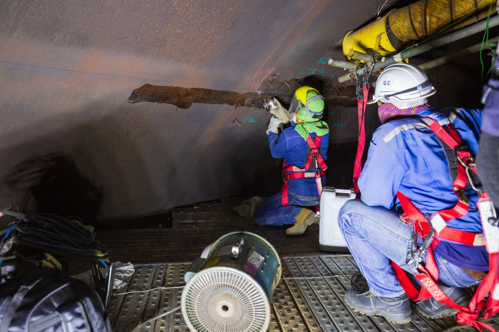 team performing confined space entry
