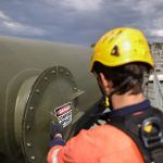 man checking confined space entry