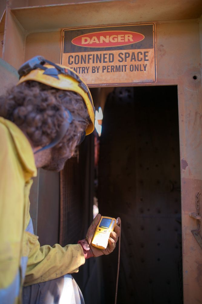 man monitoring confined space entry