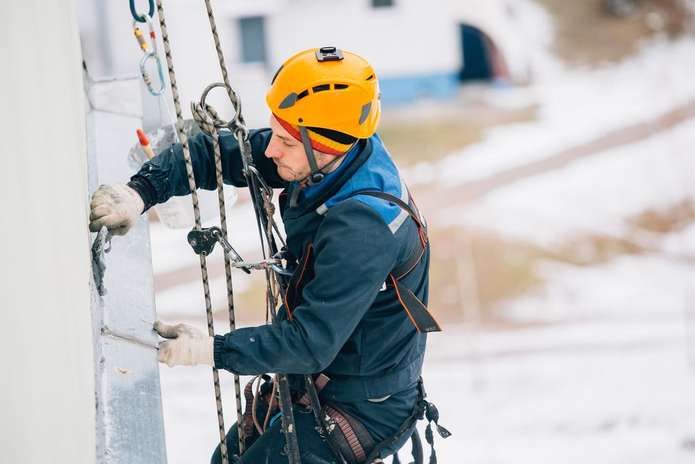 man working at heights with restraints