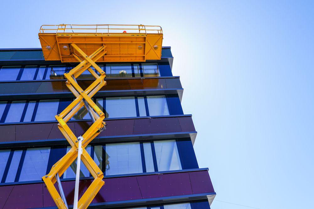 scissor lift platform cleaning windows