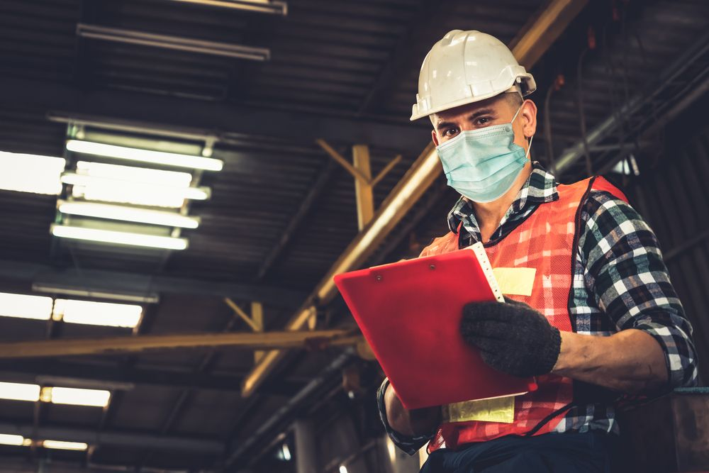worker wears covid mask on the job
