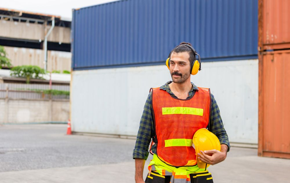 worker wears safety gear at workplace