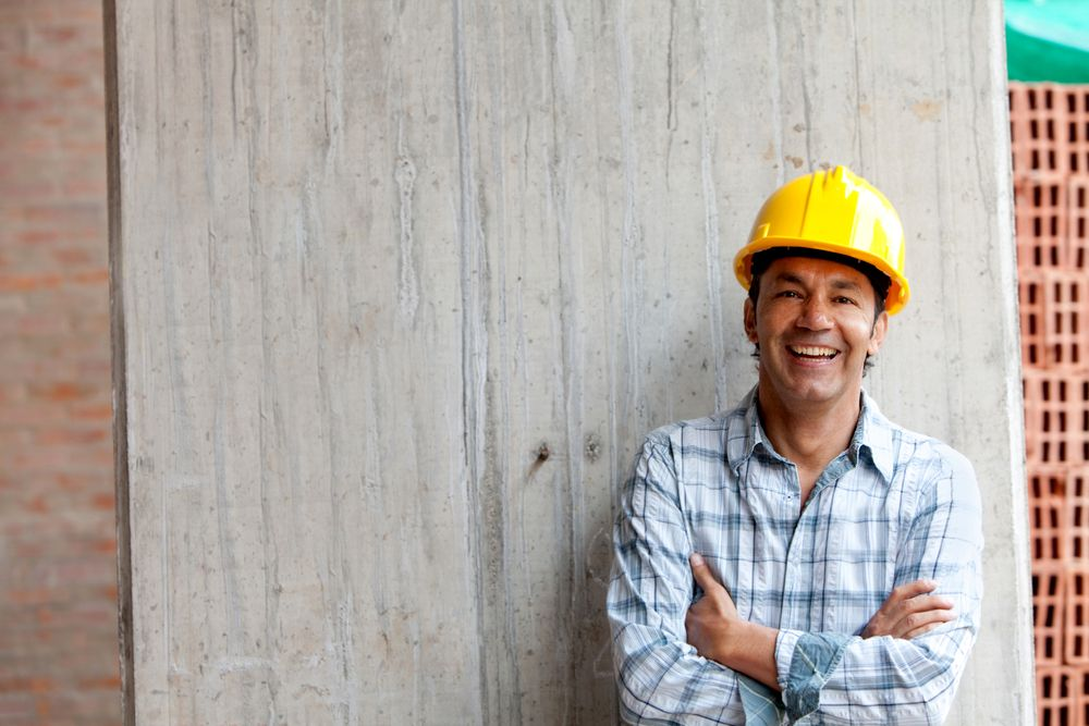 happy man working at construction site