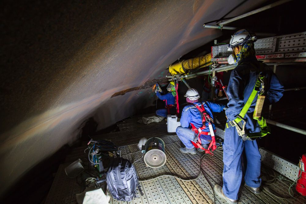 workers at a confined space